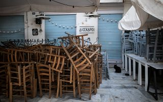 A cat is seen next to piled up chairs in front of a closed restaurant in Thissio district, following the coronavirus disease (COVID-19) outbreak, in Athens, Greece, April 28, 2020. Picture taken April 28, 2020. REUTERS/Alkis Konstantinidis