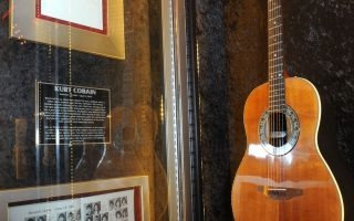 A Nirvana Ovation acoustic guitar played by Kurt Cobain is displayed at the launch of Hard Rock International's traveling music memorabilia collection,