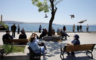 Senior Turkish citizens over 65 years old who are not allowed to go out of their houses since April 4 enjoy a sunny day in a park after being exempted from curfew for 4 hours amid the spread of the coronavirus disease (COVID-19), in Istanbul, Turkey, May 10, 2020. REUTERS/Umit Bektas