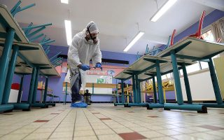 A disinfection squad cleans a classroom of Saint Exupery primary school in Cannes as France prepares for the gradual lifting of lockdown restrictions during the outbreak of the coronavirus disease (COVID-19) in France, May 5, 2020.     REUTERS/Eric Gaillard