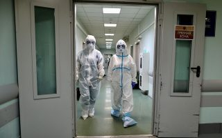 Medical specialists wearing personal protective equipment (PPE) walk in the hospital No. 1 named after N.I. Pirogov, which delivers treatment to patients infected with the coronavirus disease (COVID-19), in Moscow, Russia May 23, 2020. Kirill Zykov/Moscow News Agency/Handout via REUTERS ATTENTION EDITORS - THIS IMAGE HAS BEEN SUPPLIED BY A THIRD PARTY. MANDATORY CREDIT.