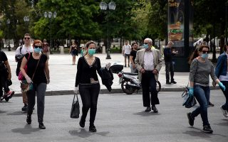 People wearing protective face masks make their way on Syntagma square, following the spread of coronavirus disease (COVID-19), in Athens, Greece, May 12, 2020. REUTERS/Alkis Konstantinidis