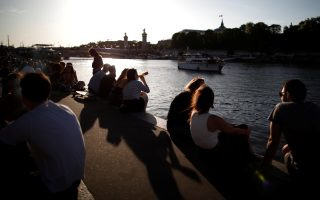 People sit along the Seine river banks during hot weather in Paris, as France gradually lifts the coronavirus disease (COVID-19) lockdown, France, May 29, 2020. REUTERS/Benoit Tessier