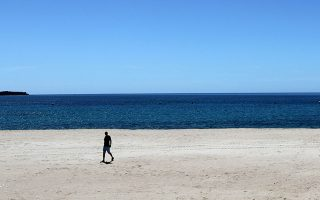 A man walks on the deserted beach of La Croisette during the outbreak of the coronavirus disease (COVID-19) in Cannes, France, May 4, 2020.     REUTERS/Eric Gaillard
