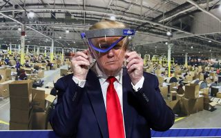 U.S. President Donald Trump holds up a protective face shield during a tour of the Ford Rawsonville Components Plant that is manufacturing ventilators, masks and other medical supplies during the coronavirus disease (COVID-19) pandemic in Ypsilanti, Michigan, U.S., May 21, 2020. REUTERS/Leah Millis     TPX IMAGES OF THE DAY