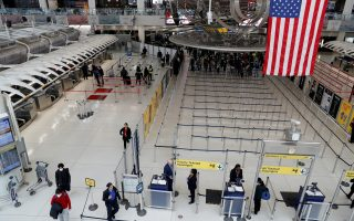 FILE PHOTO: Passengers walk through Terminal 1, after further cases of coronavirus were confirmed in New York, at JFK International Airport in New York, U.S., March 13, 2020. REUTERS/Shannon Stapleton/File Photo