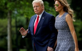 U.S. President Donald Trump walks with first lady Melania Trump as they depart for travel to the Kennedy Space Center in Florida from the South Lawn at the White House in Washington, U.S., May 27, 2020. REUTERS/Carlos Barria