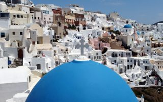 FILE PHOTO: A view of Oia, following the coronavirus disease (COVID-19) outbreak, on the island of Santorini, Greece, May 7, 2020. Picture taken with a drone. REUTERS/Alkis Konstantinidis/File Photo