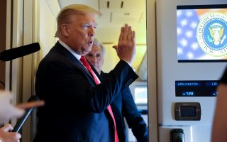 U.S. President Donald Trump speaks to reporters aboard Air Force One while returning to Washington  from Cape Canaveral, Florida, U.S. May 30, 2020. REUTERS/Jonathan Ernst