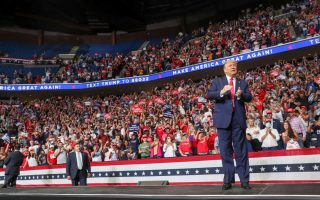 U.S. President Donald Trump reacts to the crowd as he arrives onstage at his first re-election campaign rally in several months in the midst of the coronavirus disease (COVID-19) outbreak, at the BOK Center in Tulsa, Oklahoma, U.S., June 20, 2020. REUTERS/Leah Millis