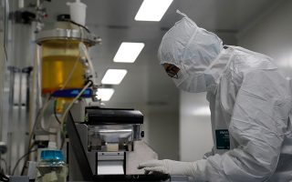 A scientist inputs data for automatic product diafiltration during the research and development of a vaccine against the coronavirus disease (COVID-19) at a laboratory of BIOCAD biotechnology company in Saint Petersburg, Russia June 11, 2020. REUTERS/Anton Vaganov