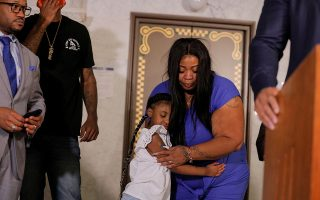 George Floyd's 6-year-old daughter, Gianna, embraces her mother, Roxie Washington, before speaking about her father, following his death in Minneapolis police custody, at the Minneapolis City Hall, in Minneapolis, U.S., June 2, 2020. REUTERS/Lucas Jackson