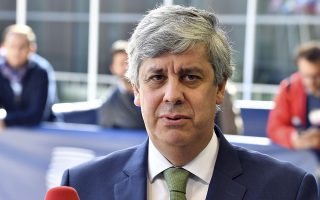 Portuguese Economy Minister Mario Centeno speaks with the media as he arrives for a meeting of eurogroup finance ministers at the European Council building in Luxembourg, Monday, Oct. 1, 2018. (AP Photo/Geert Vanden Wijngaert)