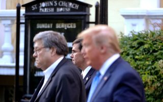 U.S. Defense Secretary Mark Esper and U.S. Attorney General Bill Barr walk with U.S. President Donald Trump to a photo opportunity in front of St. John's Episcopal Church across from the White House during ongoing protests over racial inequality in the wake of the death of George Floyd while in Minneapolis police custody, outside the White House in Washington, U.S., June 1, 2020. REUTERS/Tom Brenner