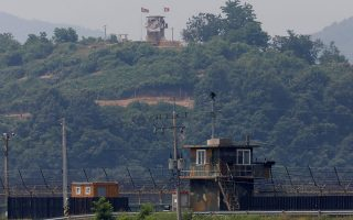 A North Korean soldier stands guard at his guard post inside North Korean territory, in this picture taken from Paju, South Korea, near the demilitarized zone (DMZ) separating the two Koreas, June 17, 2020.   REUTERS/Kim Hong-Ji