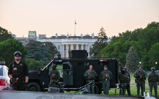 SWAT personnel stand with their vehicle outside the White House during a protest amid nationwide unrest over the death in Minneapolis police custody of George Floyd, in Washington, U.S., May 31, 2020. REUTERS/Erin Scott