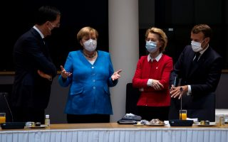 Dutch Prime Minister Mark Rutte, German Chancellor Angela Merkel, European Commission President Ursula von der Leyen and French President Emmanuel Macron during a meeting on the sidelines of the first face-to-face EU summit since the coronavirus disease (COVID-19) outbreak, in Brussels, Belgium July 18, 2020. Francisco Seco/Pool via REUTERS