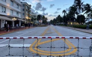 A barrier blocks a street after the 8 pm curfew, imposed due to Florida's climbing numbers of coronavirus disease (COVID-19) cases, in Miami Beach, Florida, U.S. July 18, 2020.  REUTERS/Liza Feria