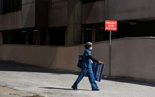 A healthcare worker leaves Houston Methodist Hospital, as social distancing guidelines to curb the spread of the coronavirus disease (COVID-19) are relaxed in Houston, Texas, U.S. May 4, 2020. REUTERS/Callaghan O'Hare