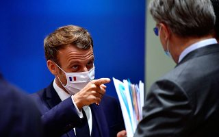 France's President Emmanuel Macron gestures during a round table meeting at the first face-to-face EU summit since the coronavirus disease (COVID-19) outbreak, in Brussels, Belgium July 20, 2020. John Thys/Pool via REUTERS
