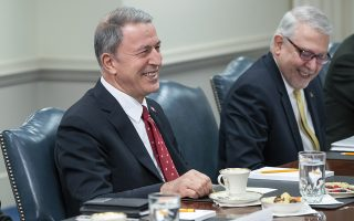 epa07388752 Turkish Minister of Defense Hulusi Akar (L) and Turkish Ambassador to the US Serdar Kilic (R) react during a bilateral meeting with Acting US Secretary of Defense Patrick Shanahan at the Pentagon in Arlington, Virginia, USA, 22 February 2019. The group discussed the continuing fight to defeat IS and other regional military issues.  EPA/ERIK S. LESSER