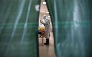 A medical worker is seen inside the red zone, where patients suffering from the coronavirus disease (COVID-19) are being treated, at the General Hospital, in Novi Pazar, Serbia, July 23. 2020. Picture taken July 23, 2020. REUTERS/Marko Djurica