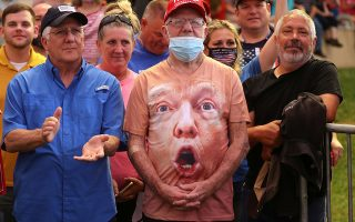 Supporters, one wearing a shirt with U.S. President Donald Trump's face, react as Trump speaks during a campaign event at Smith Reynolds Regional Airport in Winston-Salem, North Carolina, U.S., September 8, 2020. REUTERS/Jonathan Ernst     TPX IMAGES OF THE DAY