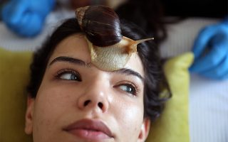 Norma Rashia, 22, undergoes facial massage with Giant African land snails, which some claim boost collagen in the skin, at a centre in Amman, Jordan September 16, 2020. Picture taken September 16, 2020. REUTERS/Muhammad Hamed