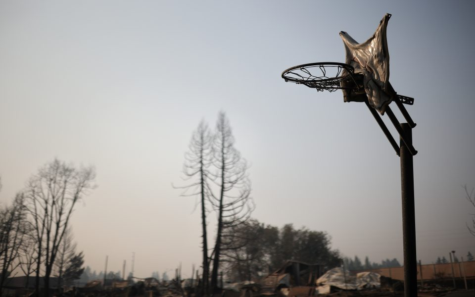 A melted basketball backboard is seen after wildfires destroyed a neighbourhood in Bear Creek, Phoenix, Oregon, U.S., September 10, 2020. REUTERS/Carlos Barria
