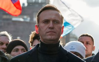 FILE PHOTO: Russian opposition politician Alexei Navalny takes part in a rally to mark the 5th anniversary of opposition politician Boris Nemtsov's murder and to protest against proposed amendments to the country's constitution, in Moscow, Russia February 29, 2020. REUTERS/Shamil Zhumatov//File Photo