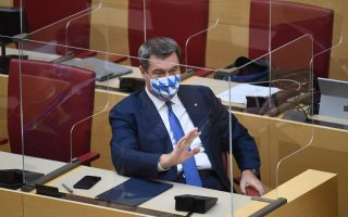 Bavarian Prime Minister Markus Soeder wearing a face mask prepares to speak during a state government declaration, in Munich, Germany, October 21, 2020. REUTERS/Andreas Gebert