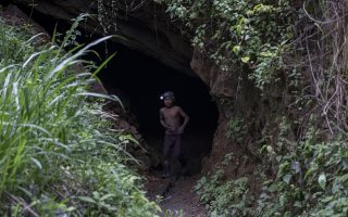 "Andres Gomez, 11, exits the amber mine where he works near the community of Jotolchen II in Chiapas state, Mexico, Thursday, Sept. 10, 2020. Since the start of the new coronavirus pandemic lockdown, Andres works in the mine hoping to find a piece of amber for which a middleman might pay him $1 to $5, but what he really wants is ""To learn to read and write,"" he said. (AP Photo/Eduardo Verdugo)"
