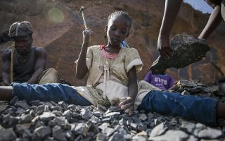Irene Wanzila, 10, works breaking rocks with a hammer along with her younger brother, older sister and mother, who says she was left without a choice after she lost her cleaning job at a private school when coronavirus pandemic restrictions were imposed, at Kayole quarry in Nairobi, Kenya Tuesday, Sept. 29, 2020. The United Nations says the COVID-19 pandemic risks significantly reducing gains made in the fight against child labor, putting millions of children at risk of being forced into exploitative and hazardous jobs, and school closures could exacerbate the problem. (AP Photo/Brian Inganga)