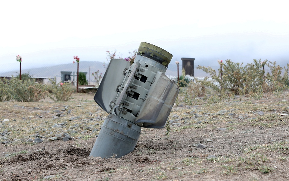 FILE PHOTO: The remains of a rocket shell are seen near a graveyard in the town of Ivanyan (Khojaly) in the breakaway region of Nagorno-Karabakh, October 1, 2020. Vahram Baghdasaryan/Photolure via REUTERS  ATTENTION EDITORS - THIS IMAGE HAS BEEN SUPPLIED BY A THIRD PARTY./File Photo