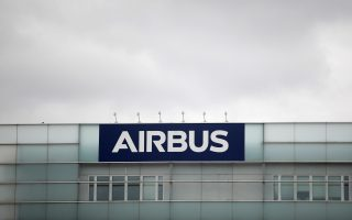 FILE PHOTO: A logo of Airbus is seen at the entrance of its factory in Blagnac near Toulouse, France, July 2, 2020.  REUTERS/Benoit Tessier/File Photo  GLOBAL BUSINESS WEEK AHEAD