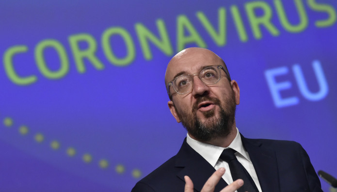European Council President Charles Michel speaks during a media conference on the European Union response to the COVID-19 crisis at EU headquarters in Brussels, Wednesday, April 15, 2020. The European Union moved Wednesday to head off a chaotic and potentially disastrous easing of restrictions that are limiting the spread of the coronavirus, warning its 27 nations to move very cautiously as they return to normal life and base their actions on scientific advice. (John Thys, Pool Photo via AP)