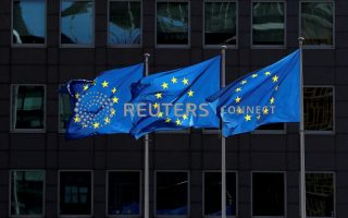 FILE PHOTO: European Union flags flutter outside the European Commission headquarters in Brussels, Belgium August 21, 2020. REUTERS/Yves Herman/File Photo