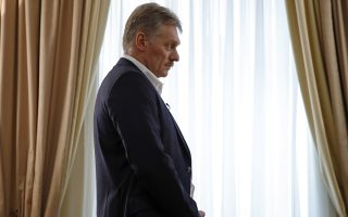 President Vladimir Putin's spokesman Dmitry Peskov speaks with The Associated Press in Moscow, Russia, Thursday, April 6, 2017.  Peskov told The Associated Press that Russia's support for Syrian President Bashar Assad is not unconditional, with Putin's Spokesman talking just days after a suspected chemical weapons attack on a Syrian rebel-held province.(AP Photo/Pavel Golovkin)