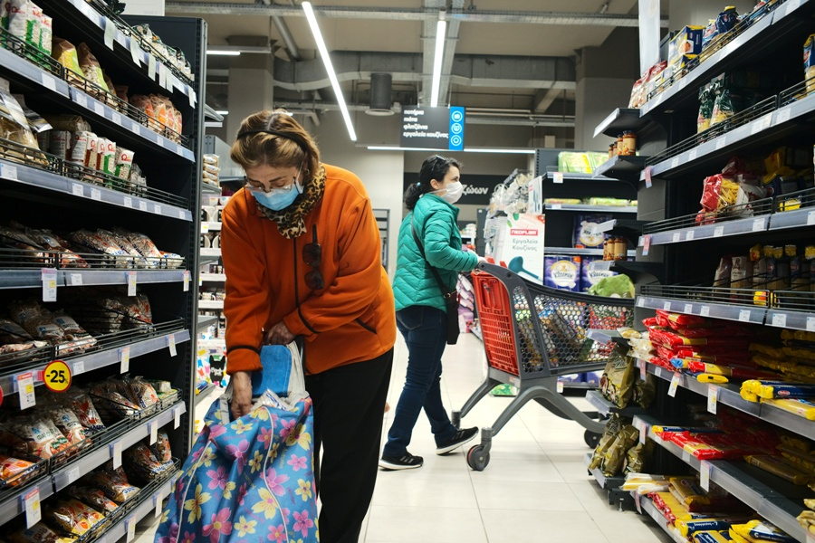 People wearing protective face masks shop in a super market in Athens, Greece, March 13, 2020. REUTERS/Constantina Peppa