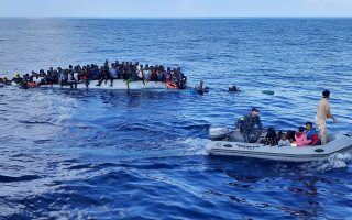 Migrants on a rubber dinghy are pictured during a rescue operation, off the coast of Libya in the Mediterranean Sea, November 13, 2020. Picture taken November 13, 2020. REUTERS/STRINGER NO RESALES. NO ARCHIVES