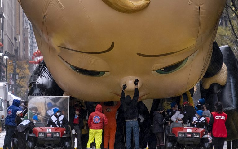 The Boss Baby balloon is deflated as it ends its appearance during the modified Macy's Thanksgiving Day Parade in New York, Thursday, Nov. 26, 2020. The annual parade goes on but only after great changes as compared to previous years due to the current deadly pandemic. (AP Photo/Craig Ruttle)