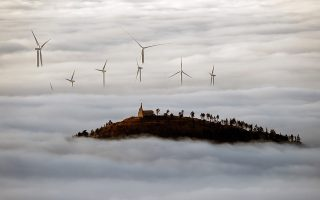epaselect epa08815311 Fog covers a windmill field close to Pamplona, Navarra, northern of Spain, 12 November 2020.  EPA/JESUS DIGES