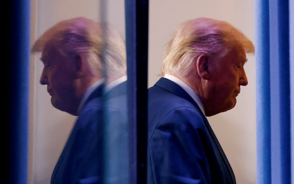 FILE PHOTO: U.S. President Donald Trump is reflected as he departs after speaking about the 2020 U.S. presidential election results in the Brady Press Briefing Room at the White House in Washington, U.S., November 5, 2020. REUTERS/Carlos Barria/File Photo