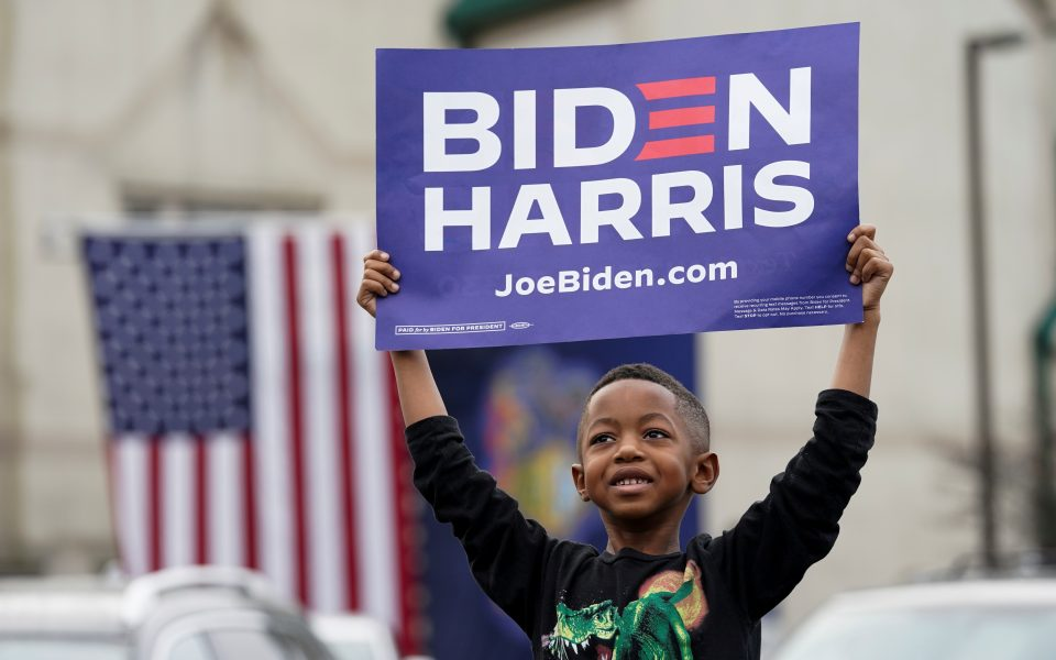 A child holds a sign as he attends U.S. Democratic presidential candidate Joe Biden's campaign event in Philadelphia, Pennsylvania, U.S., November 1, 2020. REUTERS/Kevin Lamarque     TPX IMAGES OF THE DAY