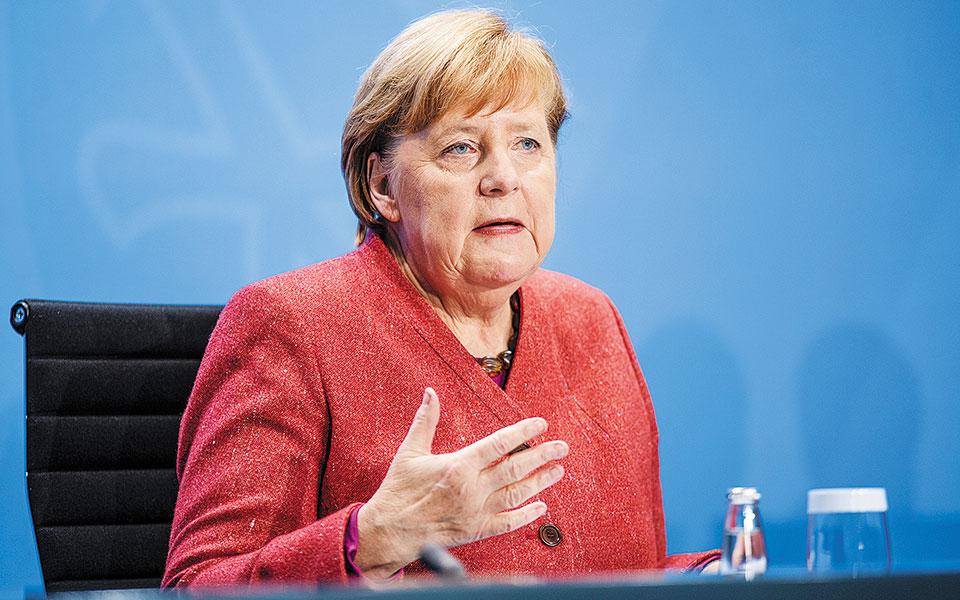 Η κ. Μέρκελ δήλωσε ότι το 2021 θα είναι μια «δύσκολη» χρονιά, αν και άφησε περιθώρια αισιοδοξίας για ανάκαμψη με τη συνδρομή του εμβολίου (φωτ. EPA).