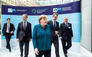 H Γερμανίδα καγκελάριος Άγκελα Μέρκελ και ο Έλληνας πρωθυπουργός Κυριάκος Μητσοτάκης στο Ελληνογερμανικό Οικονομικό Φόρουμ «Όραμα και ευκαιρίες επενδύσεων», στο Βερολίνο.