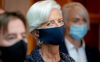 FILE PHOTO: European Central Bank (ECB) President Christine Lagarde wears a protective mask as she attends the Informal Meeting of Ministers for Economics and Financial Affairs in Berlin, Germany, September 11, 2020.    Kay Nietfeld/Pool via REUTERS/File Photo