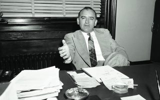 "Sen. Joseph McCarthy, right, talk to newsmen after a ""peace"" conference  April 13, 1953 on an issue revolving around the Wisconsin senator's efforts to restrict or stop Greek shipping to communist areas. Stassen once accused McCarthy of undermining state department foreign policy objectives but later softened his remarks. After the conference, Stassen said he ""would be pleased to receive any inform from McCarthy and added he would ""check it, evaluate it and report to his committee on the results."" McCarthy said the meting was"