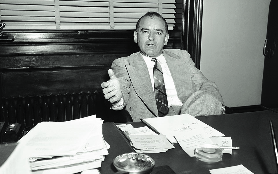 """Sen. Joseph McCarthy, right, talk to newsmen after a """"peace"""" conference  April 13, 1953 on an issue revolving around the Wisconsin senator's efforts to restrict or stop Greek shipping to communist areas. Stassen once accused McCarthy of undermining state department foreign policy objectives but later softened his remarks. After the conference, Stassen said he """"would be pleased to receive any inform from McCarthy and added he would """"check it, evaluate it and report to his committee on the results."""" McCarthy said the meting was"""