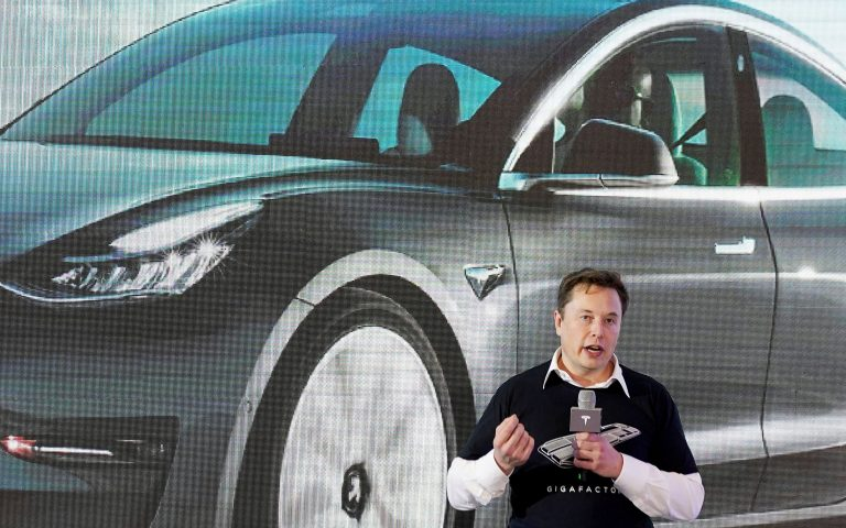 FILE PHOTO: FILE PHOTO: Tesla Inc CEO Elon Musk speaks onstage during a delivery event for Tesla China-made Model 3 cars at its factory in Shanghai, China January 7, 2020. REUTERS/Aly Song/File Photo/File Photo